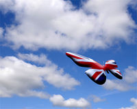 Union Jack butterfly. In cloudy sky stock photos