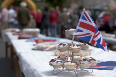 Union Jack cakes on a table. Cupcakes sat on a table decorated with the Union Jack flag Stock Image