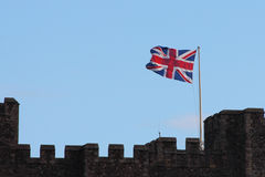 The Union Jack and castle. The National flag of the United Kingdom/Great Britain.The Union Jack/ flag flying over the Parapets of an English castle UK Royalty Free Stock Images