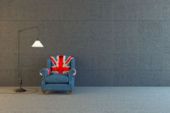 Union JAck chair. In concrete room Stock Photography