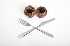 Union Jack chocolate cupcakes with fork and knife against white background Royalty Free Stock Image