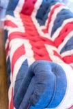 Union Jack Colored Sofa. Single Union Jack British flag colored home sofa Royalty Free Stock Images