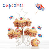 Union Jack Cupcakes. On stand with a white background Royalty Free Stock Photo