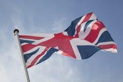 Union Jack Flag. British Flag against Blue Background Stock Photos