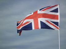 Union Jack Flag. Of Great Britan flying in the wind stock image