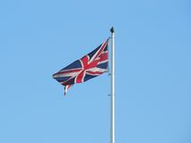 Union jack flag against a clear blue sky Stock Photos