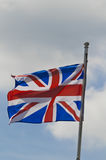 Union jack flag. The union jack flag blowing in the wind, England UK royalty free stock photography