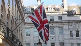 Union Jack Flag. British Union Jack flag at pole in London stock video