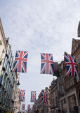 Union Jack Flag Bunting in New Bond Street. London, UK - June 16, 2016 : Union Jack Flag bunting in New Bond Street, London, to mark the 90th birthday of Queen Royalty Free Stock Image