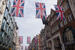 Union Jack Flag Bunting in New Bond Street, London. London, UK - June 16, 2016 : Union Jack Flag bunting in New Bond Street, London, to mark the 90th birthday royalty free stock photos