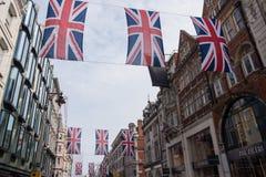 Union Jack Flag Bunting in New Bond Street, London. London, UK - June 16, 2016 : Union Jack Flag bunting in New Bond Street, London, to mark the 90th birthday Royalty Free Stock Photos