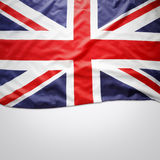Union Jack flag. Closeup of Union Jack flag on plain background. Copy space stock photo