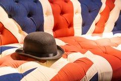 Union Jack Flag English Sofa and Bowler Hat. Union Jack Flag style modern cushioned sofa with black felt bowler hat Royalty Free Stock Photography