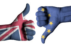 Union Jack flag and European flag on human male hands Stock Image