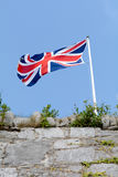 Union Jack flag flying. Above Plymouth Hoe, Plymouth, Devon, EnglAND stock photography