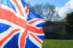 Union Jack flag. Flying over grass at parliament square London royalty free stock photos