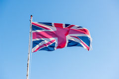 Union jack flag. Flying from pole royalty free stock photography