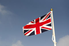 Union Jack flag. The Union Jack, Great Britain's flag flying against a blue sky royalty free stock photos