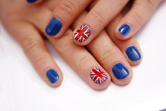 Union Jack flag on nails. Union Jack polished nails, hands of a woman Stock Photo