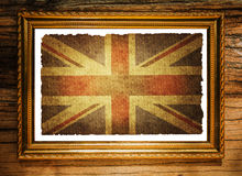 Union jack flag in Picture frame. On the wooden wall Royalty Free Stock Images