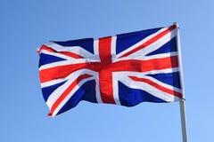 Union Jack flag. A Union Jack flag on a flag pole on a bright sunny day stock photography