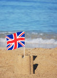 Union Jack flag on a pretty beach Stock Images