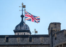 Union Jack flag rises above Tower of London Royalty Free Stock Photos