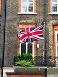 Union Jack Flag. The Union Jack, the flag of the United Kingdom, on the facade of a Victorian house. Photo taken in the area of Russell Square in central London Royalty Free Stock Images