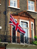 Union Jack Flag. The Union Jack, the flag of the United Kingdom, on the facade of a Victorian house. Photo taken in the area of Russell Square in central London Royalty Free Stock Photos