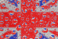 Union Jack Flag through Water Droplets. The blue, red and white Union Jack (National Flag of the United Kingdom) reflected through water droplets stock photos