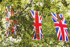 Union Jack flag waving above Bruton Street in London. LONDON, UNITED KINGDOM - August 12th, 2016: Union Jack flag waving above Bruton Street in the affluent area Royalty Free Stock Photos