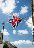 Union jack flag waving on london city street Royalty Free Stock Photos