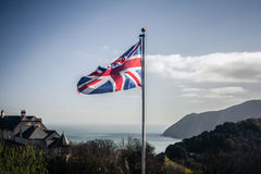 Union jack flag in the wind. Union jack flag blowing in the wind on the English coast stock image