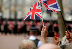 Union Jack flags. Abstract Union Jack Flags with troops in the foreground Trooping The Colour 2016 Stock Image