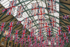 Union jack flags in Covent garden. Hanging Union jack flags in Covent garden Royalty Free Stock Image