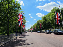 Union Jack Flags Near Buckingham Palace - London, England. Union Jack flags line The Mall roadway , leading to Buckingham Palace, in London, England Stock Photography