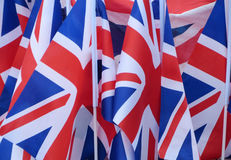 Union Jack flags for sale. Closeup of British Union Jack flags for sale in city street Stock Image