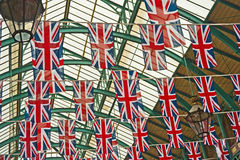 Union Jack flags in Silver Jubilee. Union Jack flags decorating roof of Covent Garden  Market during Queen Elizabeth's Silver Jubilee Celebrations Royalty Free Stock Photo