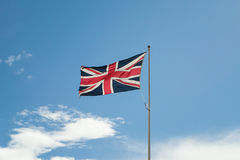 Union Jack (Union Flag) of Great Britain. Union Jack flying with a blu sky as background Stock Photos