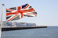 Union Jack Flying over Dover. Union Jack flying over White Cliffs of Dover.  Composite image Royalty Free Stock Image