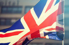 Union jack flying in the sky Stock Images