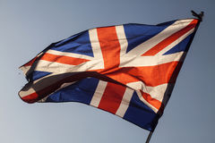 Union jack flying in the sky Royalty Free Stock Image