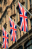 Union Jack. National English, British Flag of the UK hung from a London street building Stock Photography