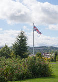 Union Jack In The Park. The Union Jack flag blowing gently in a summer breeze Stock Images