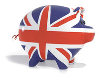 Union jack piggy bank. Piggy back covered in union jack colours isolated on a white background Stock Image