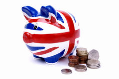 Union jack pippy bank. English money with a union jack piggy bank on white background stock photography