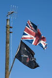 Union jack and pirate flag Stock Image