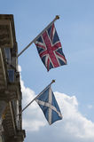 Union Jack and Saltire flags Scotland UK. The Union Jack flag of the United Kingdom next to the Saltire flag of St Andrew on a building in Perth Scotland Stock Image