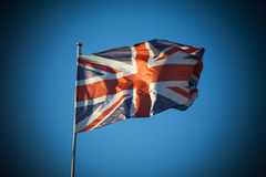 Union Jack in sunlight against clear blue sky Royalty Free Stock Image