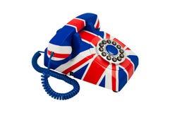 Union Jack telefon med modellen av den brittiska flaggan som isoleras på vit bakgrund Telefoncloseup Royaltyfri Bild